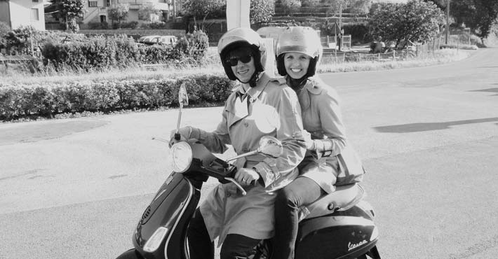 A young couple ready for a Vespa journey starting from Pisa