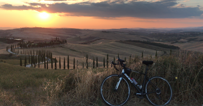 Flavia from Bucharest waiting sunset riding Siena hills